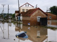 A car lies submerged in a flooded street in the village ofNovoukrainsk