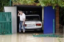 A local resident walks through a flooded street in the village ofNovoukrainsk