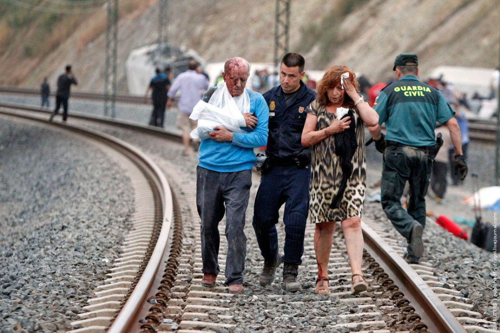 Victims receive help after a train crashed near Santiago de Compostela