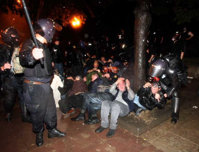 Georgian riot police catch opposition supporters during anti-government opposition rally in Tbilisi