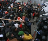 Pro-European integration protesters clash with Ukranian riot police during a rally near government administration buildings inKiev