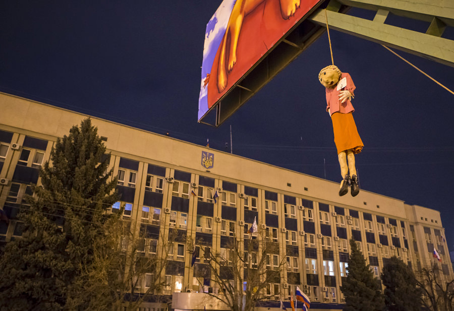 An effigy depicting Ukrainian politician and presidential candidate Yulia Tymoshenko is hanged on a advertisement board in front of the offices of the SBU state security service in Luhansk, in eastern Ukraine