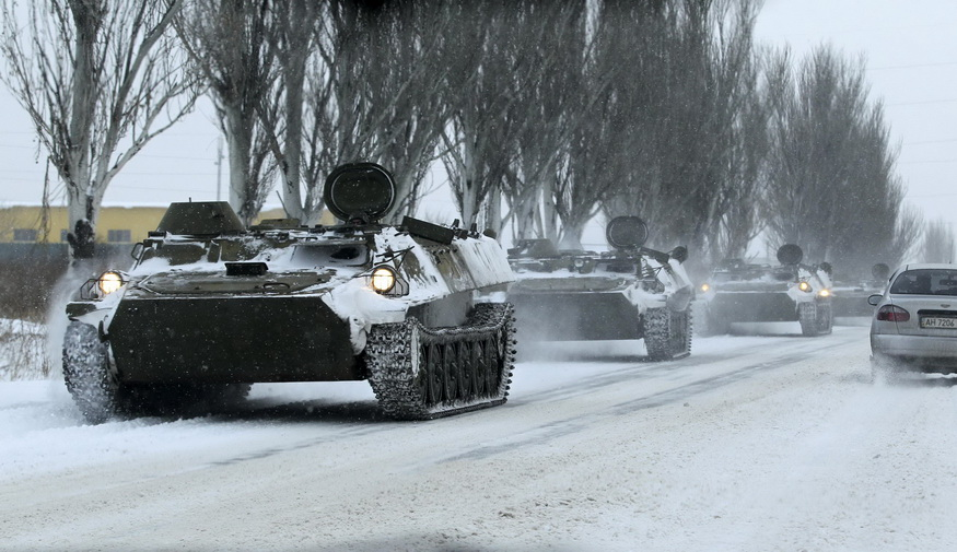 Unmarked armored personnel carrier are seen on the road from Luhansk to Donetsk in the territory controlled by the self-proclaimed Donetsk People's Republic, eastern Ukraine