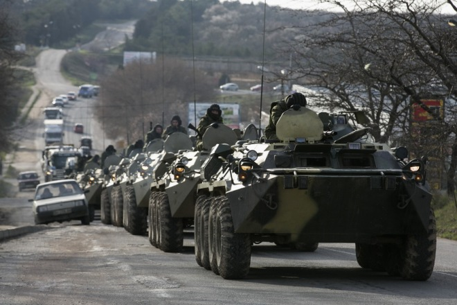 Soldiers, believed to be Russian, ride on military armoured personnel carriers on a road near the Crimean port city of Sevastopol March 10, 2014. REUTERS/Baz Ratner (UKRAINE - Tags: TPX IMAGES OF THE DAY MILITARY POLITICS) - RTR3GH7S