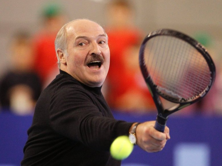 Belarussian President Alexander Lukashenko plays in a charity tennis match with Denmark's Caroline Wozniacki and Belarus' Victoria Azarenka in Minsk, November 19, 2010. REUTERS/Vasily Fedosenko (BELARUS - Tags: SPORT TENNIS POLITICS)