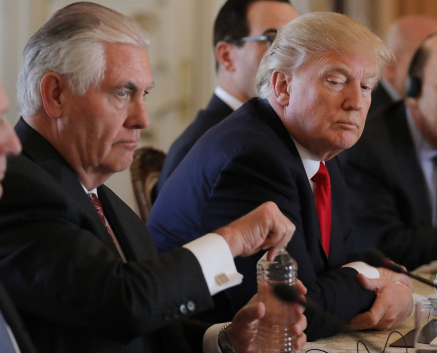 U.S. President Trump  sits with Tillerson during bilateral meeting with China's President Xi at Trump's Mar-a-Lago estate in Palm Beach