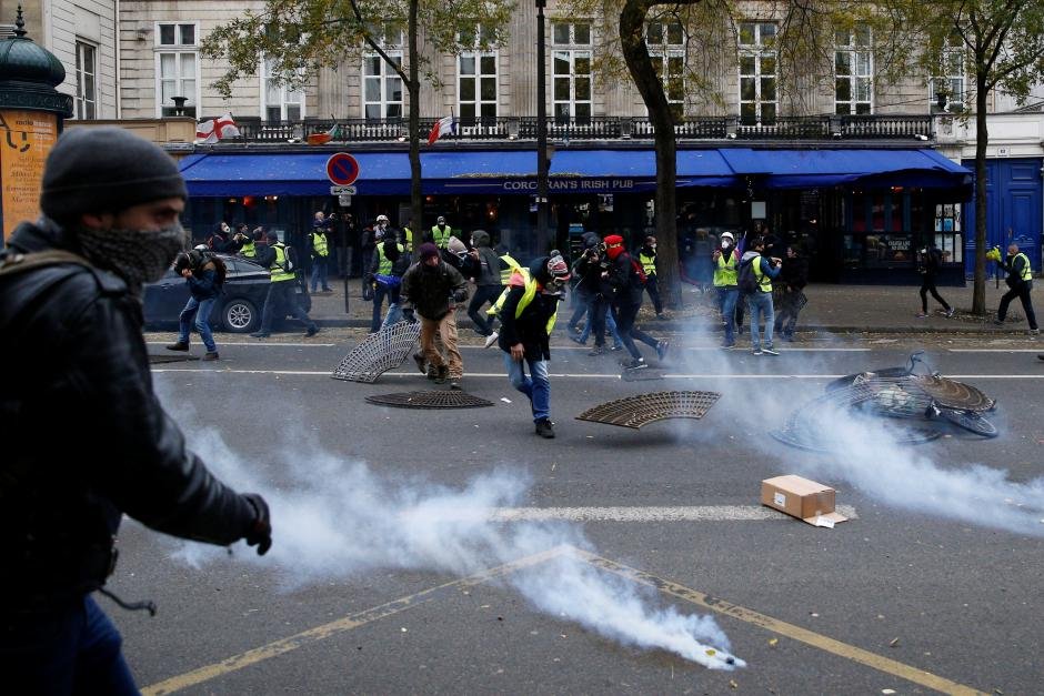 "Tear gas fills the air during clashes with police at a demonstration during a national day of protest by the ""yellow vests"" movement in Paris"